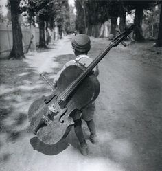 """""""The cello is the most perfect instrument aside from the human voice. --- Gypsy boy with cello, Hungary, Eva Besnyö. Black White Photos, Black And White Photography, Gypsy Life, Expositions, Vintage Photographs, Photos Vintage, Old Photos, Street Photography, Cello Photography"""