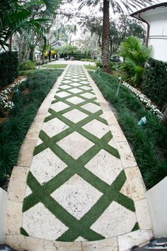 The border on this makes this path more special than just dropping square pavers in a lawn. Since my pavers will be black, maybe interplant with a white ground cover?