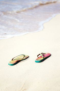 2a1dd5aa3 colorful flip flops in the sand Summer Beach