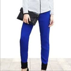 """BR Royal Blue Dressy Joggers- NWTs! Banana Republic Royal Blue Dressy Joggers- NWTs! Black band around the ankles. Size 4 Short which is great for girls of average height. Measures 31-37"""" around the top, 26"""" inseam. 2 front slit pockets. 100% polyester. Perfect casual glam look. Banana Republic Pants Track Pants & Joggers"""