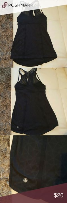 Very cute workout tank!! Built in bra, no pads. Racerback. Very good condition. When taking pics of this tank, I noticed a Very tiny pick in the fabric. I've never noticed it before and it's nearly non existent, but in full disclosure I took a pic. This tank is one of my favorites! lululemon athletica Tops Tank Tops