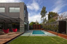 Combination of timber deck and paving around pool