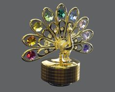 Amazon.com - 24k Gold-Plated Swarovski Crystal Figurine - Peacock (Multi-Colored Crystals) - Musical Boxes And Figurines