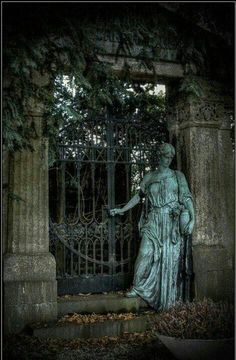 a gate to my pool area which is surrounded by greek pillars and statues of the muses on a circular patio :) in my dreamhouse garden