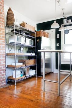 Wire shelves — frequently a staple of garage or basement organizing projects — might not be the first thing you think of adding to your kitchen, but they are incredibly useful. Not only can they hold a lot of weight (your stand mixer can find a home there, no problem), but they add a bit of an industrial look that can really complement your stainless steel appliances. Here are 12 beautiful kitchens and pantries that put the organizing staple to good use.