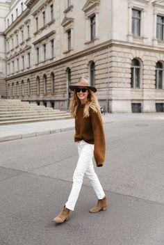 Janessa Leone hat, Acne Studios knit, Isabel Marant jeans and boots. Via Mija