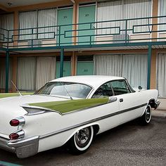 Dodge Custom Royal sits in front of a Mid-Century modern motel.