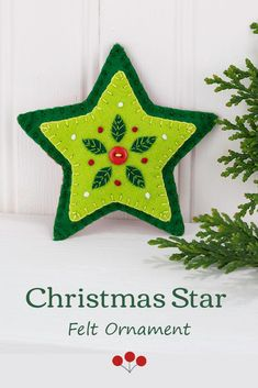 A handmade felt hanging star with embroidered leaves and berries in greens and red, decorated with a red button.A perfect gift or decoration .4.25 inches / 11cm high, with a loop for hanging. #feltchristmasornament #starornament Christmas Hearts, Felt Christmas Ornaments, Handmade Christmas, Scandi Christmas, Embroidered Leaves, Christmas Applique, Fabric Ornaments, Heart Decorations, Christmas Decorations