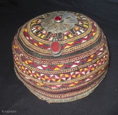 Turkmen cap with red carneole in the amulette,silver and brass. On top a red glass pearl. Pre 1900 - photo Sam Laren - rugrabbit.com