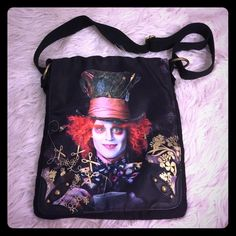 Pre loved Johnny Depp Mad Hatter Cross Body Pre-loved Disney cross body with Johnny Depp as the Mad Hatter.  In near perfect condition - ideal for a day at Disney especially with the new Alice through the Looking Glass movie coming out!  Open to reasonable offers! Disney Bags Crossbody Bags