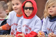 A few children have fun collecting candy during Grove City College's homecoming parade.