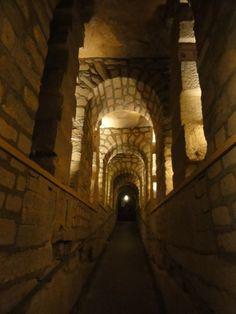 Travel through the Paris Catacombs.