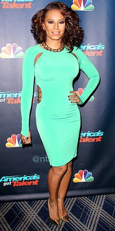 """MELANIE """"MEL B."""" BROWN We have a feeling the singer has an entire closet for all her body-con dresses. This time she chooses a green second-skin number with sheer panels at the waist and armpits (?), accessorized with a gold chain necklace and coordinating ankle-strap pumps for the America's Got Talent pre-show event in N.Y.C."""