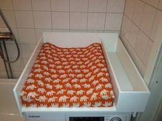 Skötbord på tvättmaskin