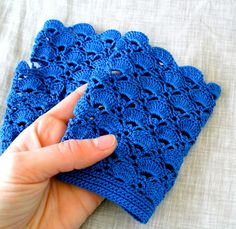 Crochet fingerless gloves by MariaKonstantin on Etsy.    Those shell design arm warmers are handcrocheted from 100% high quality cotton thread.  They are seamless, a bit stretchy and have a thumb hole.  The gloves have a 3/4 matching button for closure.    Color: royal blue  Lenght: 4 3/4 (123cm)  Wrist: fits wrist circumference 6 to 6 1/2    Handwash and lay flat to dry.    Thanks for visiting my shop.