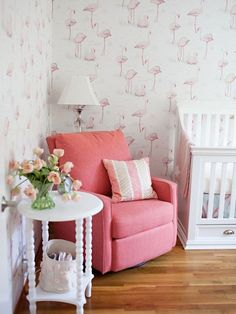 Flamingos are having their moment in the spotlight and so to is wallpaper. Now mash each of those pretty details together and this Cole & Sons papered nursery is the result. Blending vintage finds and family heirlooms with modern accessories and Bedroom Wallpaper Accent Wall, Pink Accent Walls, Nursery Wallpaper, Wallpaper Decor, Flamingo Nursery, Tropical Nursery, Tropical Bedrooms, Tropical Girl, Flamingo Decor