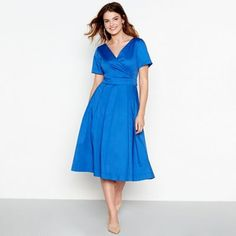 This wrap dress from J by Jasper Conran is made from soft cotton fabric with a hint of stretch and a satin shine. Featuring an elegant wrap bodice, this piece has a classic pleated dress with a self-tie waist to accentuate your figure.