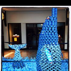 Dolphin made of tuna cans (Jif peanut butter pack for eye). Art created to go along with a food drive. Great idea to get attention!