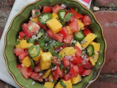 Mango-Tomato Salsa | This refreshing (and spicy) mix of mangos, tomatoes, and chiles go perfect with any spring or summer dish.