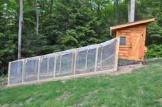 Neat hen house with a great chicken run! Use this idea on a slope! #ChickenRun www.FreeHenHousePlans.net