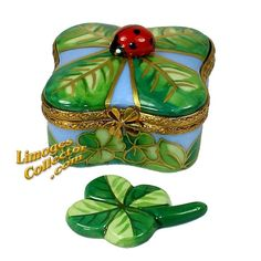 Four Leaf Clover with Lucky Ladybug Limoges Box by Beauchamp | LimogesCollector.com. Find Limoges box gifts for St. Patrick's Day and any occasion at www.LimogesCollector.com