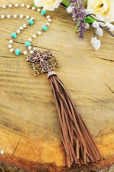 Use this as a staple for all of your outfits! Southern Grace Pearl and Turquoise Bead Leopard with Cross Tassel Necklace