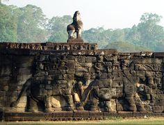 The Terrace of the Elephants is part of the walled city of Angkor Thom, a ruined temple complex in Cambodia. The terrace was used by Angkor's king Jayavarman VII as a platform from which to view his victorious returning army.