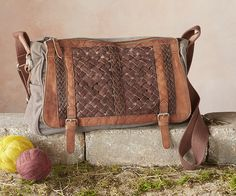 Woven World Bag -  cotton and leather bag features a handwoven leather panel, an adjustable shoulder strap.