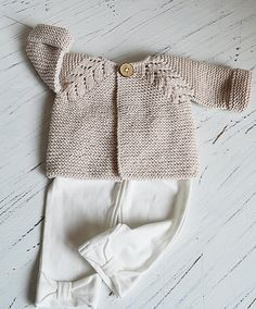 This seamless little top down baby cream cardigan is an intuitive knit, suitable for an experienced knitter. Find the pattern on LoveKnitting.com!