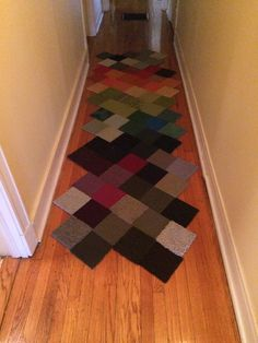 I used my collection of FLOR carpet samples to create a runner for my hallway at home.  The saturated tones bring a smile to my face everytime. #flor #carpettiles