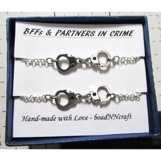 NF/LF Partners in Crime handcuff bracelets, 2x silver tone rolo chain... ($27) ❤ liked on Polyvore featuring jewelry, bracelets, long jewelry, silver tone jewelry, handcuff jewelry, friendship bracelet and silvertone jewelry