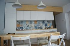 patchwork cement tiles in a minimalistic kitchen