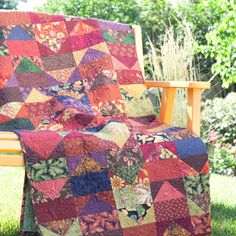 Flight of Geese Gather a bevy of fall-tone prints for a seasonal throw that showcases the classic Flying Geese block. Fall Quilts, Scrappy Quilts, Batik Quilts, Strip Quilts, Patchwork Quilting, Longarm Quilting, Quilting Projects, Quilting Designs, Quilting Ideas