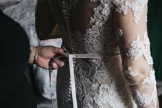 Bride in lace wedding dress from Maggie Sottero Designs.