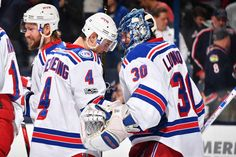 COLUMBUS, OH - JANUARY 7: Adam Clendening #4 of the New York Rangers congratulates goaltender Henrik Lundqvist #30 of the New York Rangers after defeating the Columbus Blue Jackets 5-4 on January 7, 2017 at Nationwide Arena in Columbus, Ohio. (Photo by Jamie Sabau/NHLI via Getty Images)