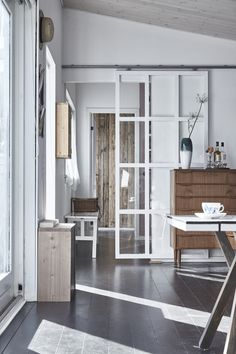 Still wondering if we can do some type of barn door to the office from the LR.  Could be reclaimed and solid but slid open, or glass with frames painted to mimic the windows to let light in and visual sight line but to cut noise.  Or even put it in place permanently with furniture in front.