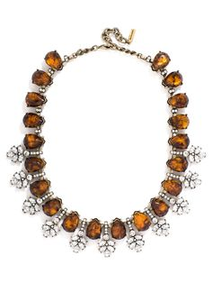 A vintage-inspired strand of embellished teardrop stones is modernized with a tortoise finish and crystal bough-like accents.