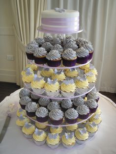 Grey and Yellow Cupcakes - nothing on top but maybe cachous... Grey and yellow cases?