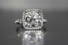 Platinum ring 5.01 Cushion cut diamond J SI2 GIA certified with 51-.47 total weight round brilliant cut diamonds