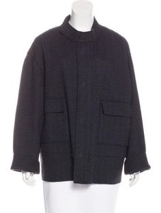 Black and midnight Marni wool-blend oversize coat with abstract pattern throughout, raw edge trim throughout, mock neck, dual flap pockets at front and concealed snap closures at center front.