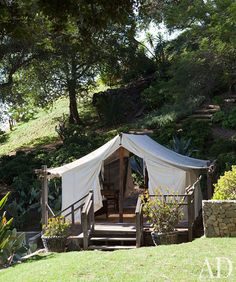 canvas tent in the backyard. Wouldn't this be a wonderful place to mediate or do some yoga in your back yard!? :)