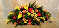 20 MT Red Gerbera, Orange Gerbera, Yellow Calla Lilles, Yellow Orchid, Green Kermit, Mixed Foliage