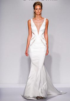 Pnina Tornai for Kleinfeld mermaid styled gown with illusion neckline and beaded appliqué details I Style: 4442 I https://www.theknot.com/fashion/4442-pnina-tornai-for-kleinfeld-wedding-dress?utm_source=pinterest.com&utm_medium=social&utm_content=july2016&utm_campaign=beauty-fashion&utm_simplereach=?sr_share=pinterest