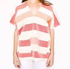 """Bold striped tunic with front pockets perfect for Summer! Handwoven in GuatemalaOne-size fits most24"""" wide x 28"""" long100% CottonShrinkage will occur. Machine wash cold water, line dry, warm iron."""