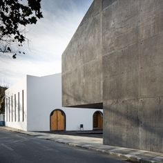Menos é Mais Arquitectos and João Mendes Ribeiro slotted both light and dark structures among stone buildings of a warehouse complex to create an art centre