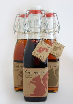 Red Squirrel bottles & labeling - the squirrel changes color depending on particular type of syrup