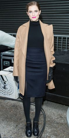 Williams stayed warm during the 88th annual Macy's Thanksgiving Day Parade with camel cocoon coat layered over a black Tory Burch turtleneck knit and a navy pencil skirt. Leather gloves, opaque tights, and moto boots completed her look.