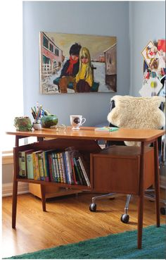 This mid century modern desk is amazing./ Nice styling...love the colorful artwork great work space