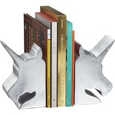 Unicorn bookends to keep your reading material in an upright position. | 36 Insanely Awesome And Inexpensive Things You Need For Your Bedroom