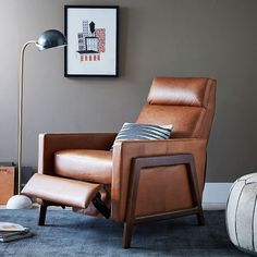 What a recliner looks like today! Love the cognac color but also comes in a soft black.  Spencer Wood Framed Leather Recliner | west elm